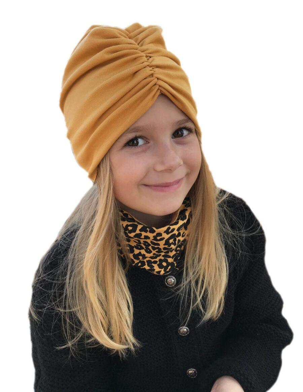 Czapka turban z marszczeniem zamiast koguta. Uszyty z pojedynczej bawełny pętelkowej typu dresówka. Marka Gracja Styl.