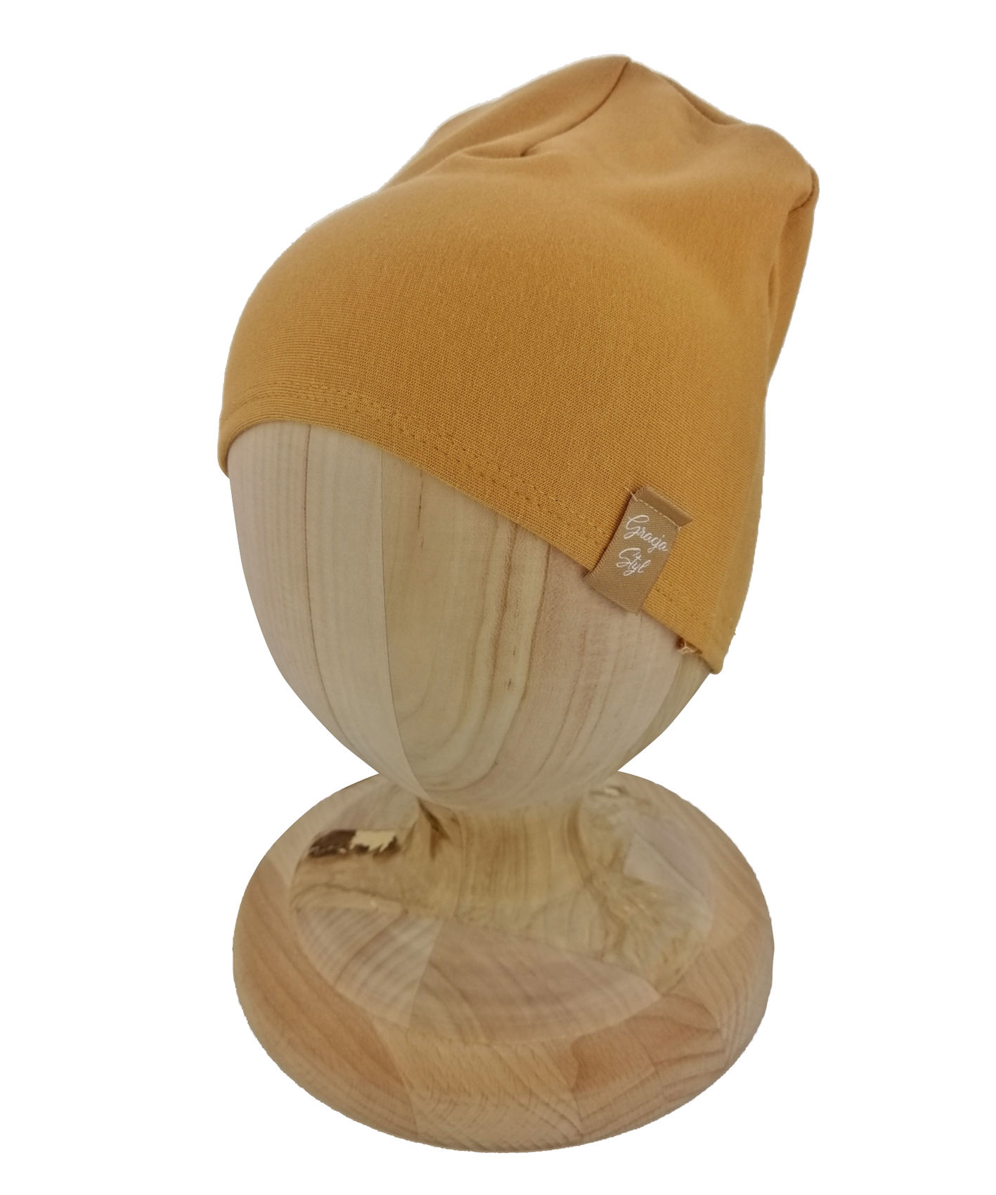 Czapka typu smerfetka, uszyta z bawełny petelkowej. Kolor musztardowy.