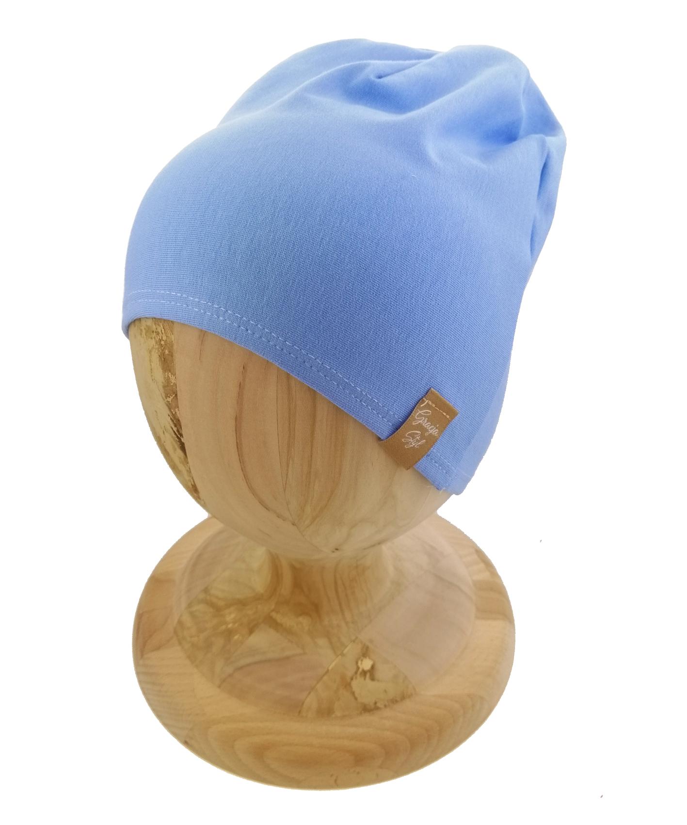 Czapka typu smerfetka, uszyta z bawełny petelkowej. Kolor pastelowy błękit.