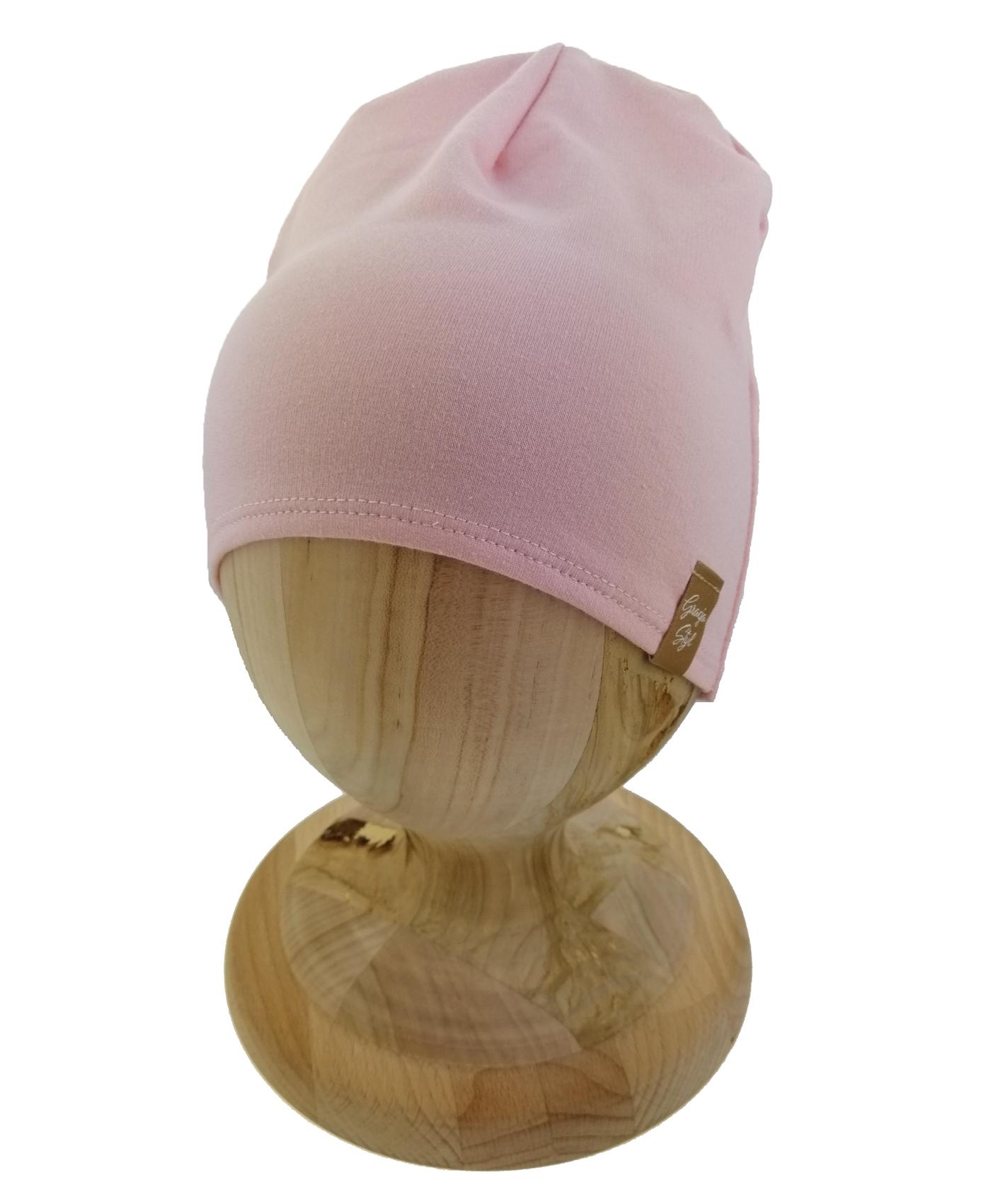 Czapka typu smerfetka, uszyta z bawełny petelkowej. Kolor różowo-łososiowy