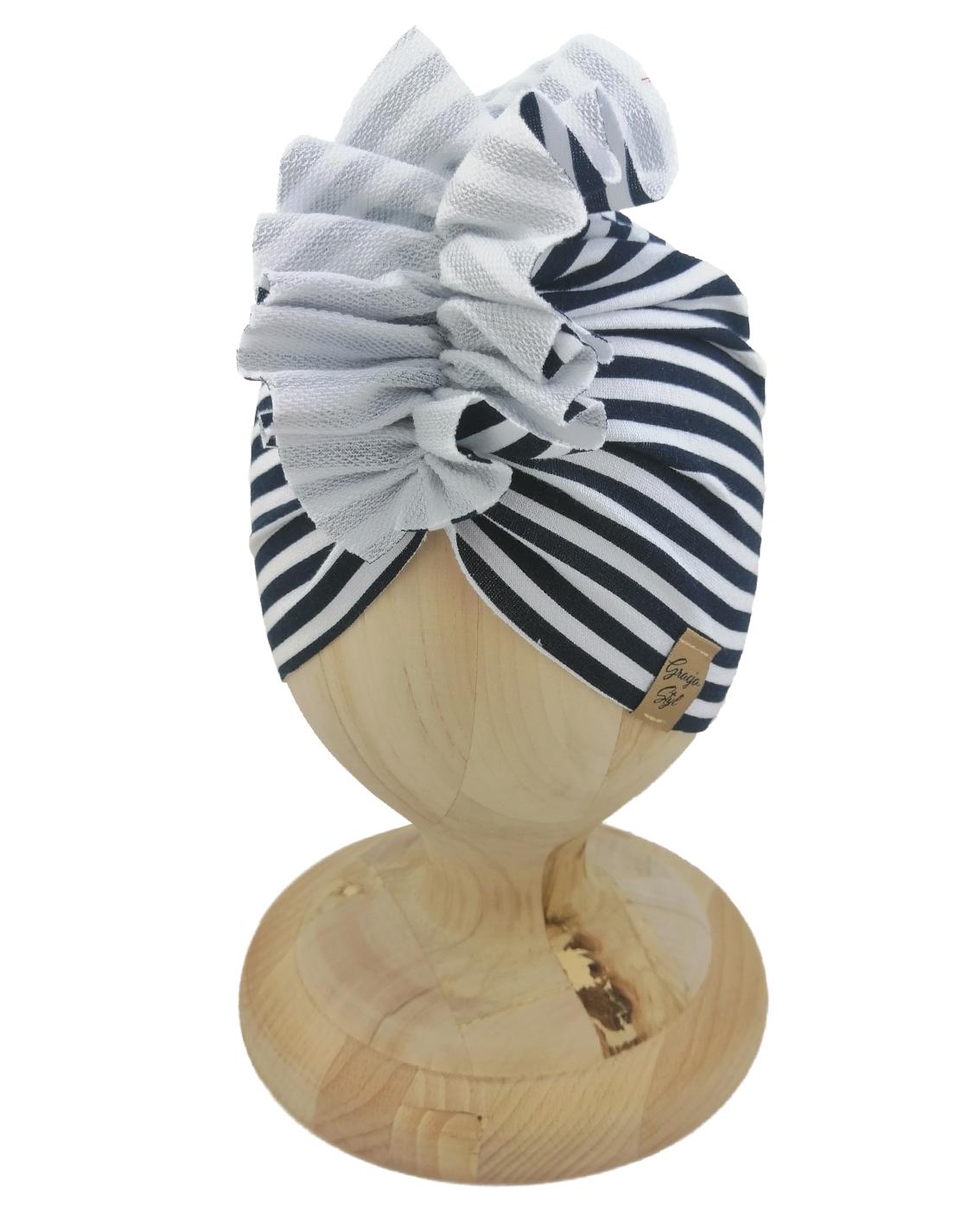 Czapka turban dziecięca marki Gracja styl. Wzór w paski biało granatowe. Produkt polski wykonany z bawełny pętelkowej typu dresówka.