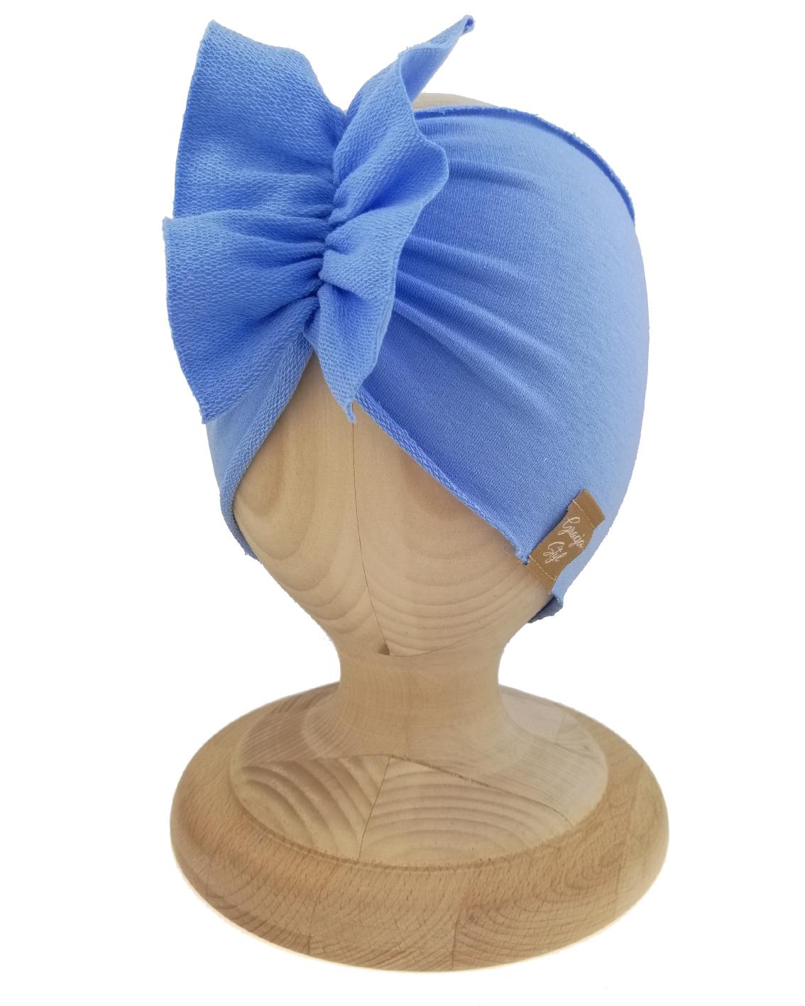 Opaska dziewczęca motylak. Uszyta z bawełny pętelkowej typu dresówka. W kolorze pastelowy błękit. Marka Gracja Styl.