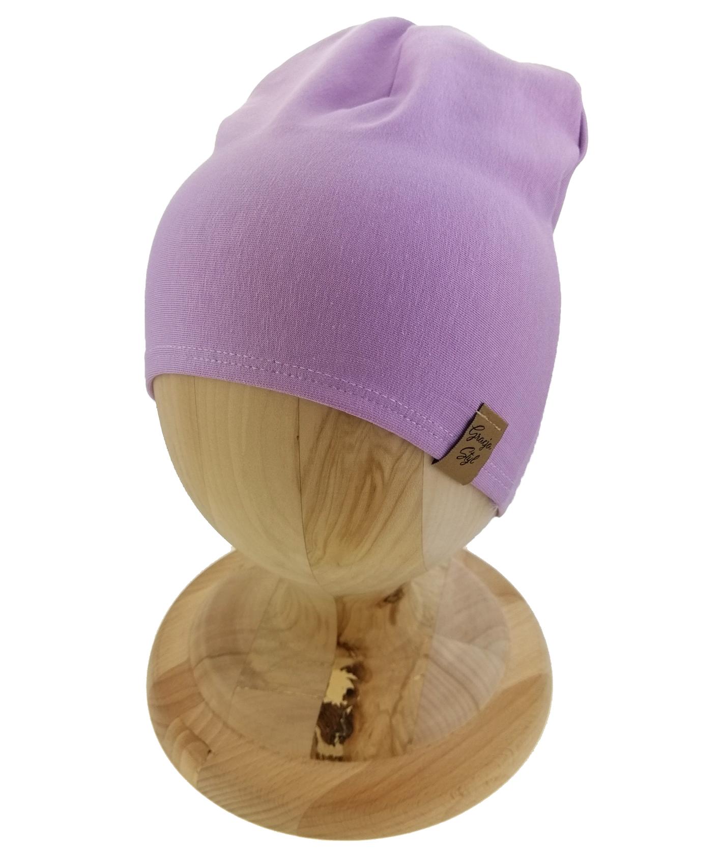 Czapka typu smerfetka, uszyta z bawełny petelkowej. Kolor liliowy.