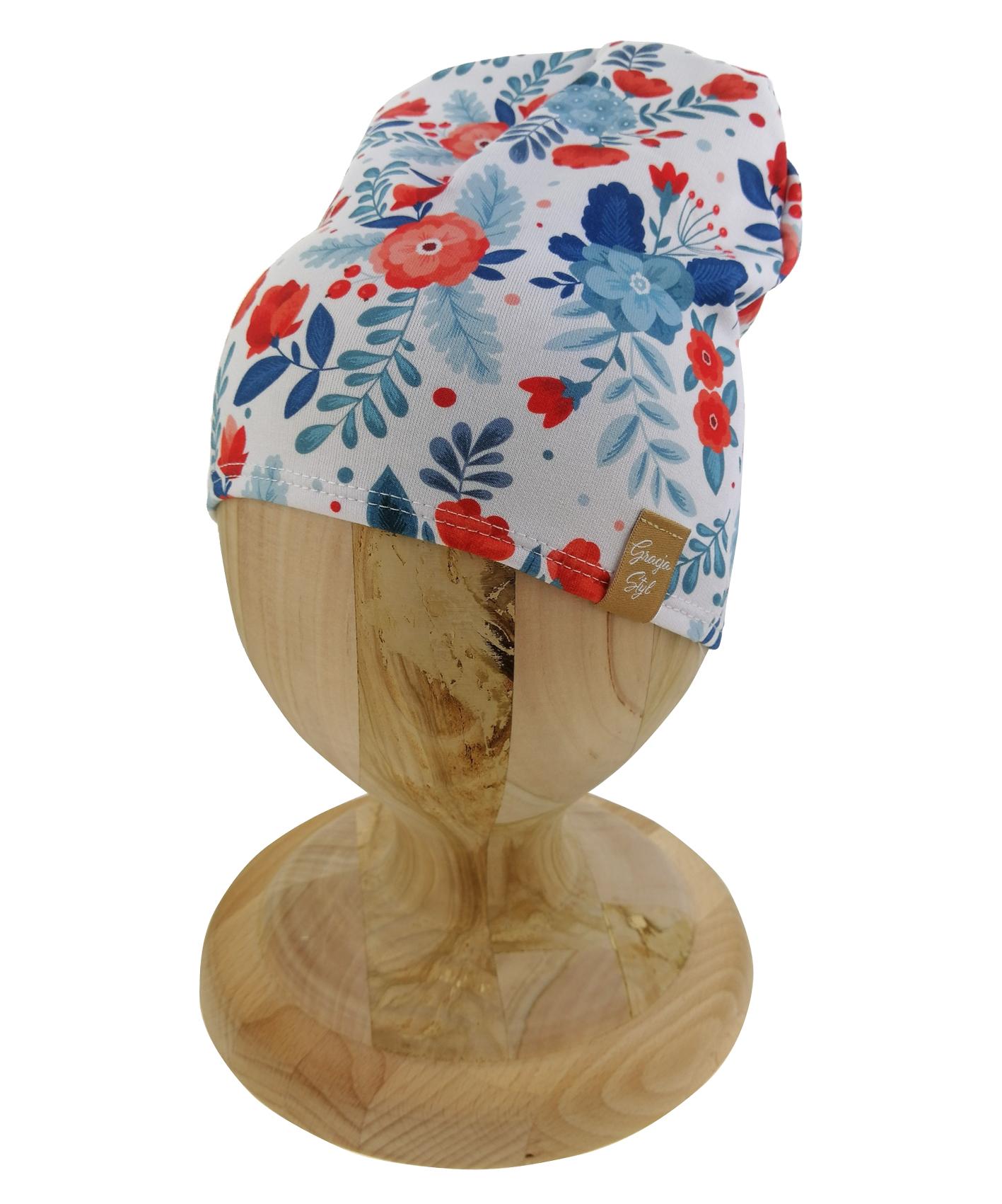 Czapka typu smerfetka. Uszyta z bawełny pętelkowej. Marka Gracja Styl. Dzięki domieszcze elastanu czapka dobrze dopasowuje się do głowy. Wzór maki