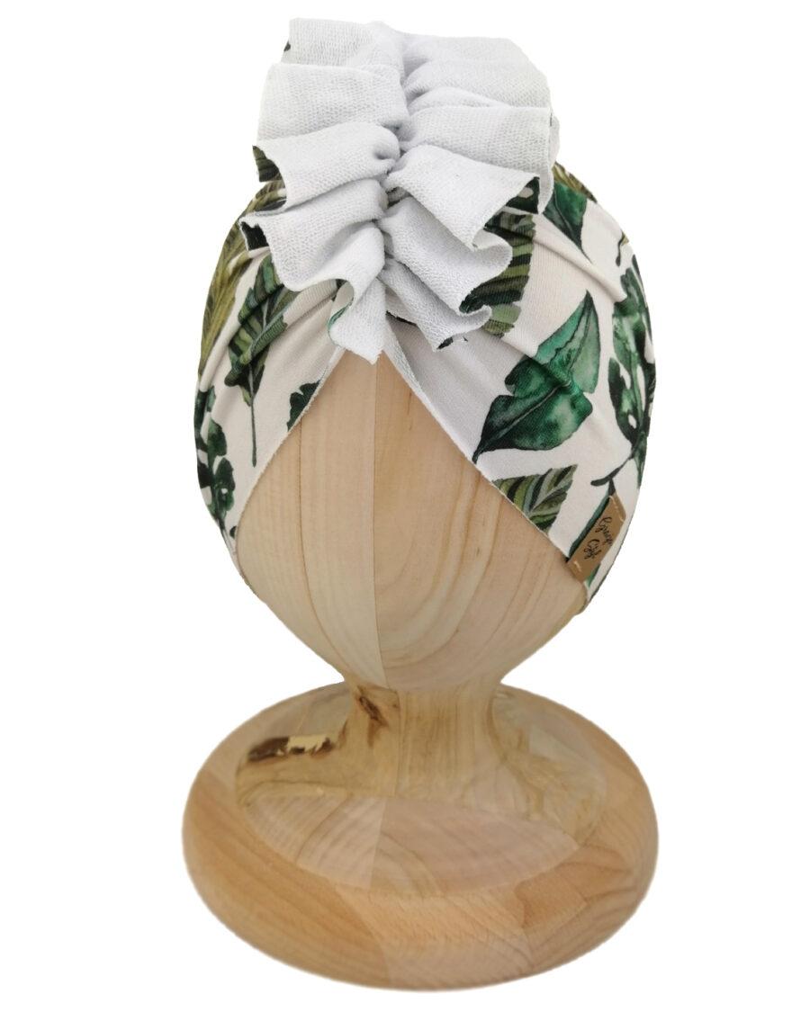 Czapka turban dziecięca marki Gracja styl. Wzór Leaves przedstawiający liście w odcieniu zieleni. Produkt polski wykonany z dresówki
