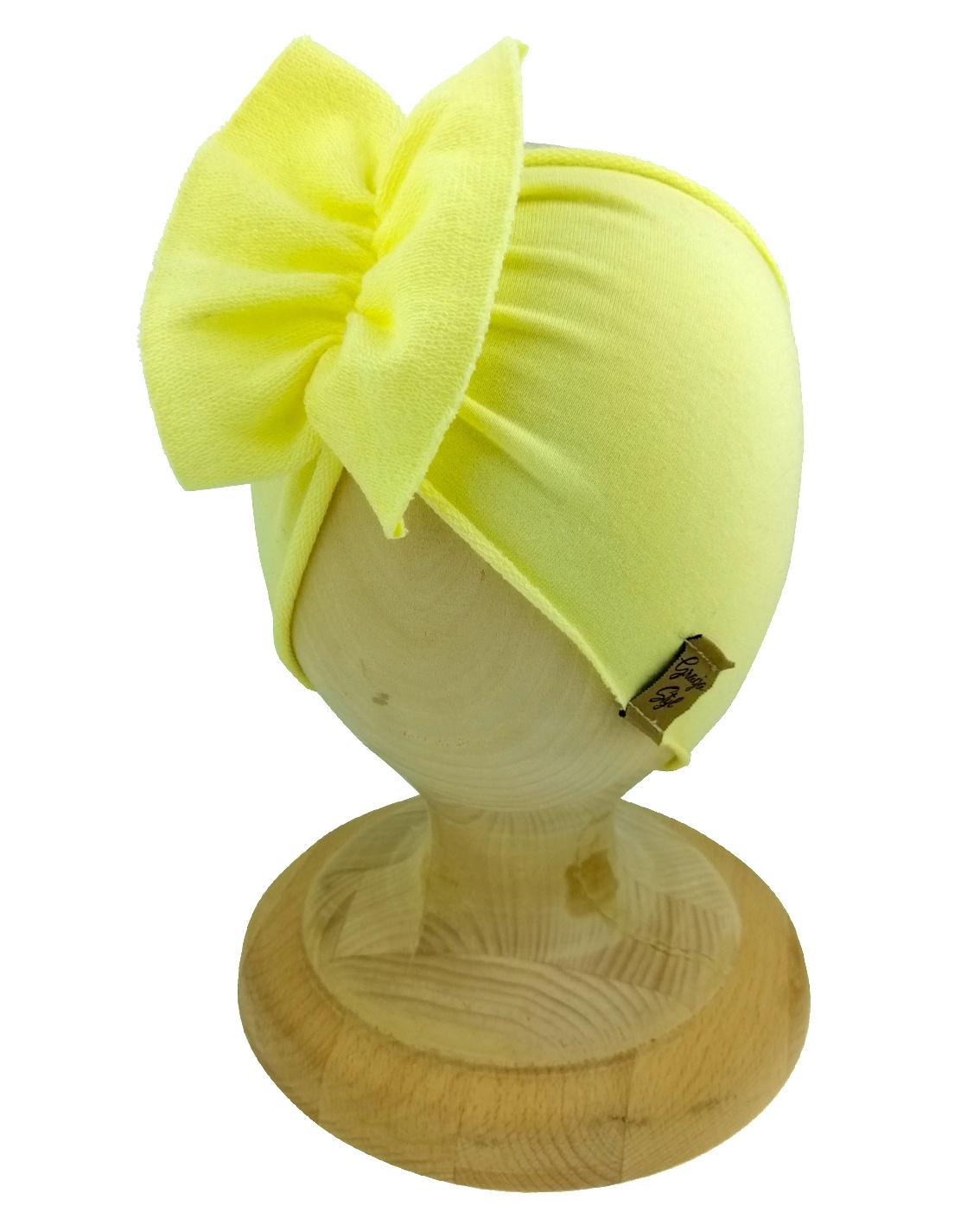 Opaska dziewczęca motylak. Uszyta z bawełny pętelkowej typu dresówka. W kolorze żółty kanarkowy. Marka Gracja Styl.