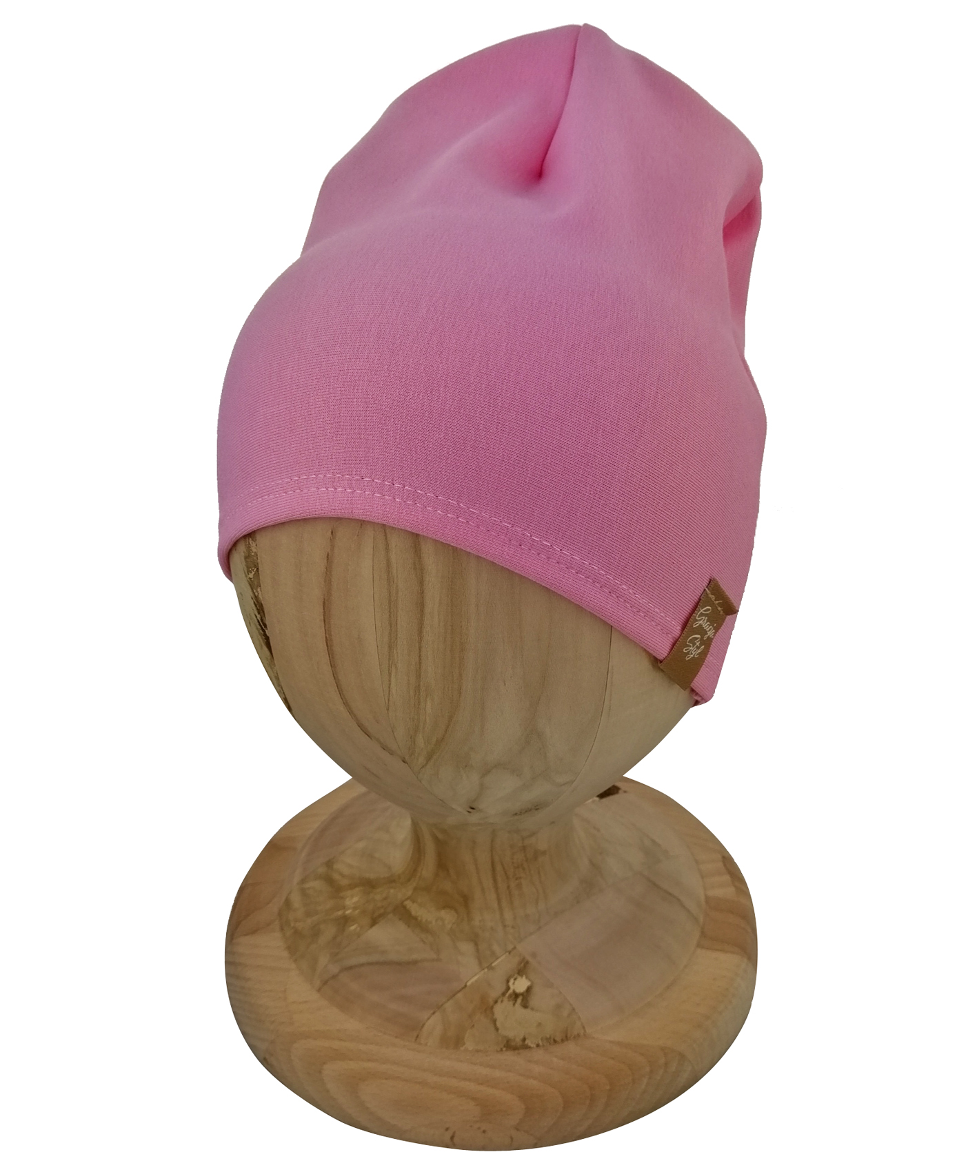 Czapka typu smerfetka, uszyta z bawełny petelkowej. Kolor różowy